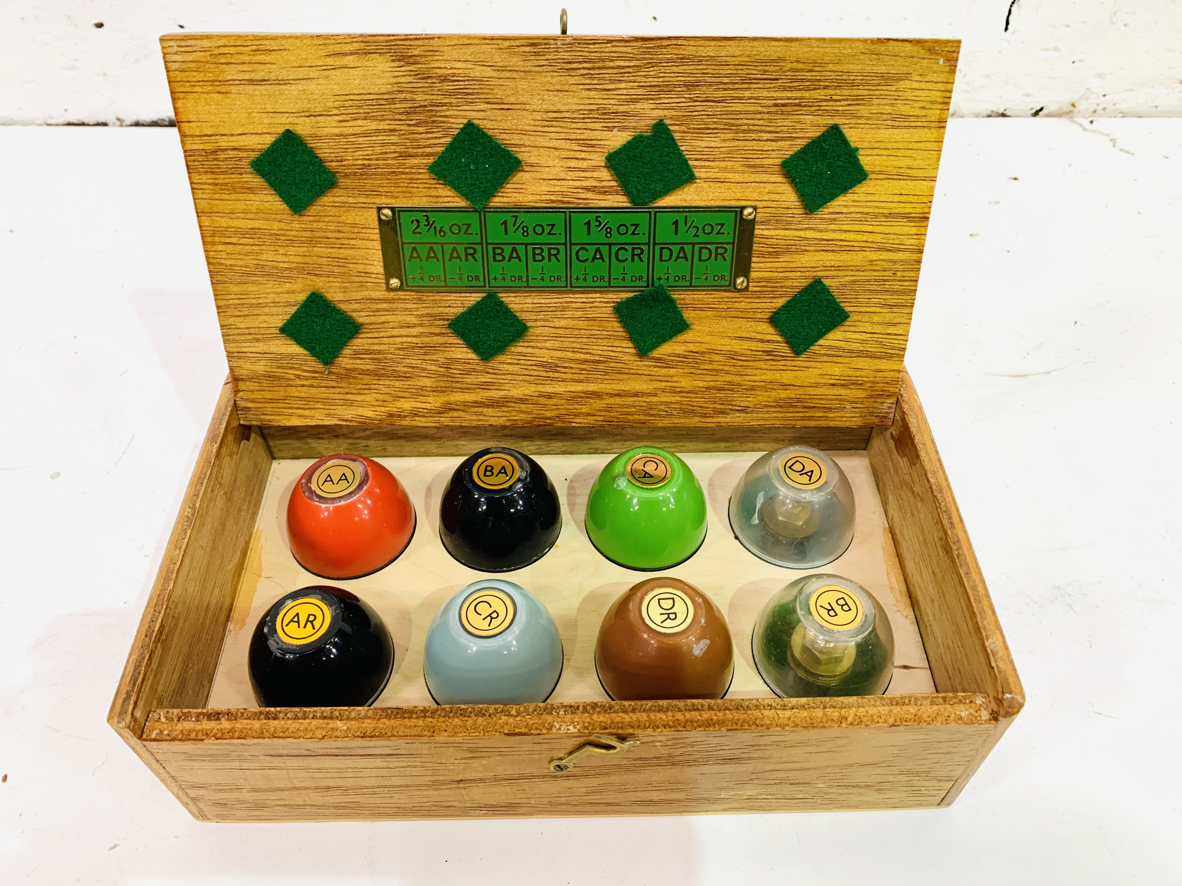 A boxed set of eight egg poisers