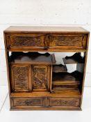 A carved hardwood Japanese cabinet