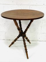 Oval mahogany occasional table on turned tripod supports