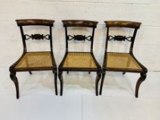 Three mahogany cane seat dining chairs