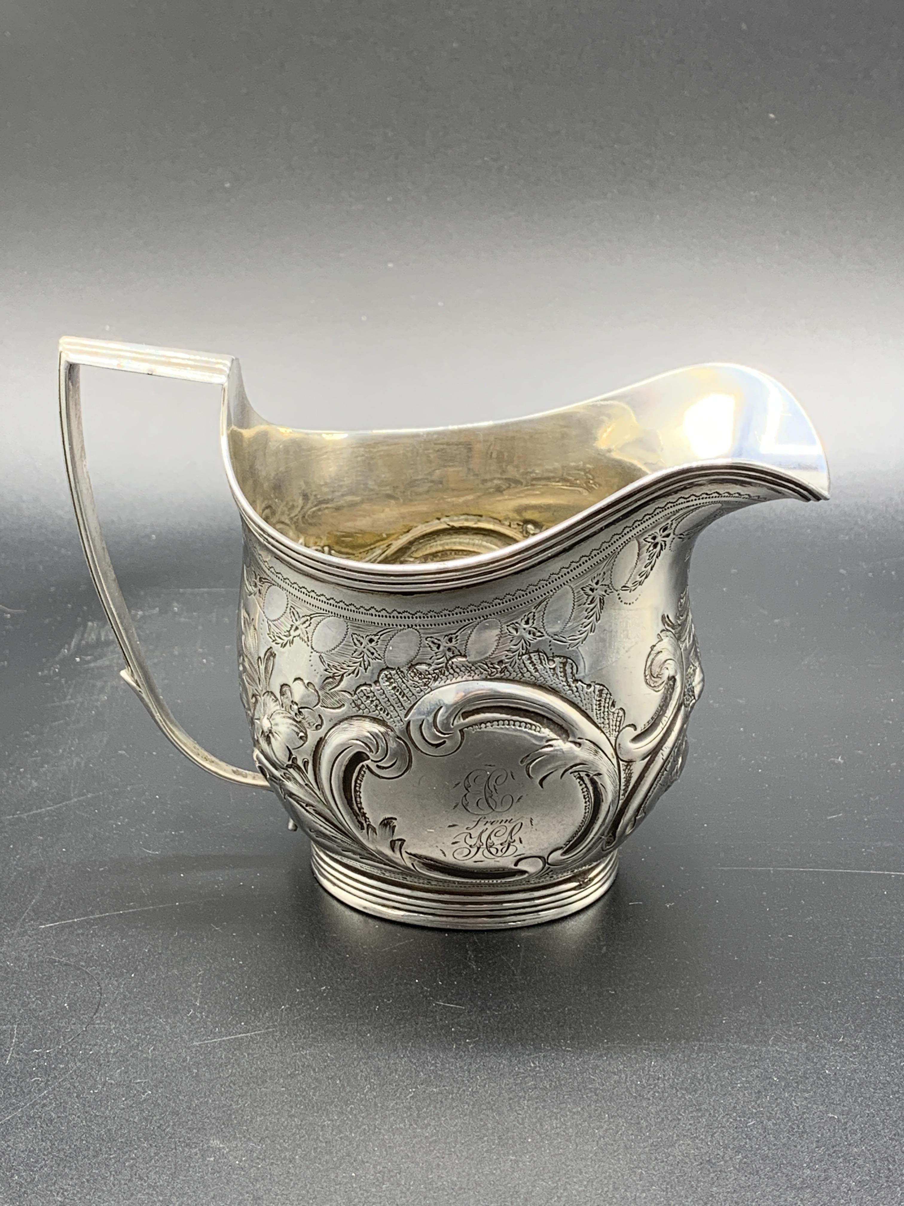 A Georgian silver cream jug hallmarked London 1807