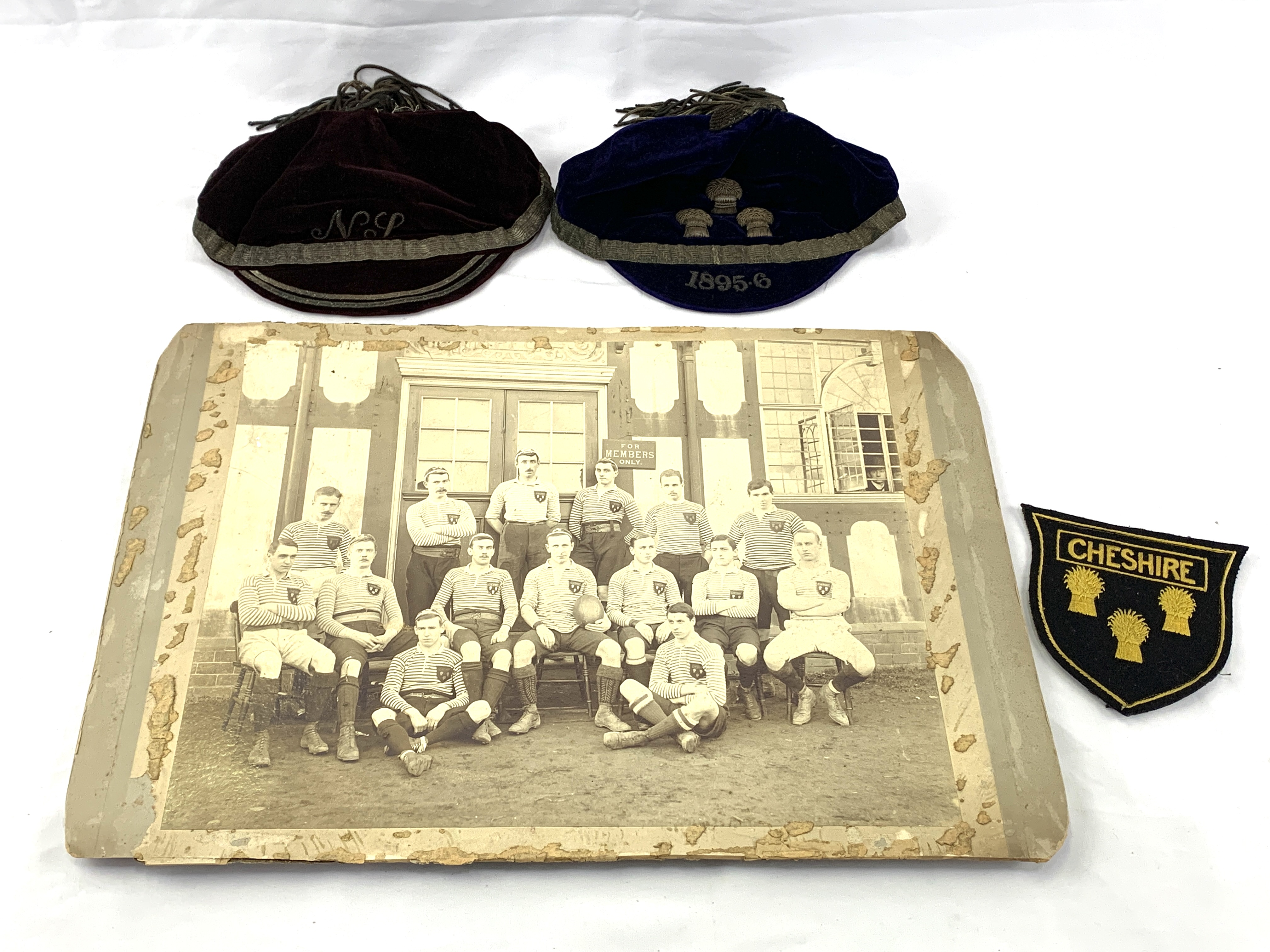 Black and white photograph of a Cheshire Rugby team circa 1895, a shirt badge and 2 velvet caps