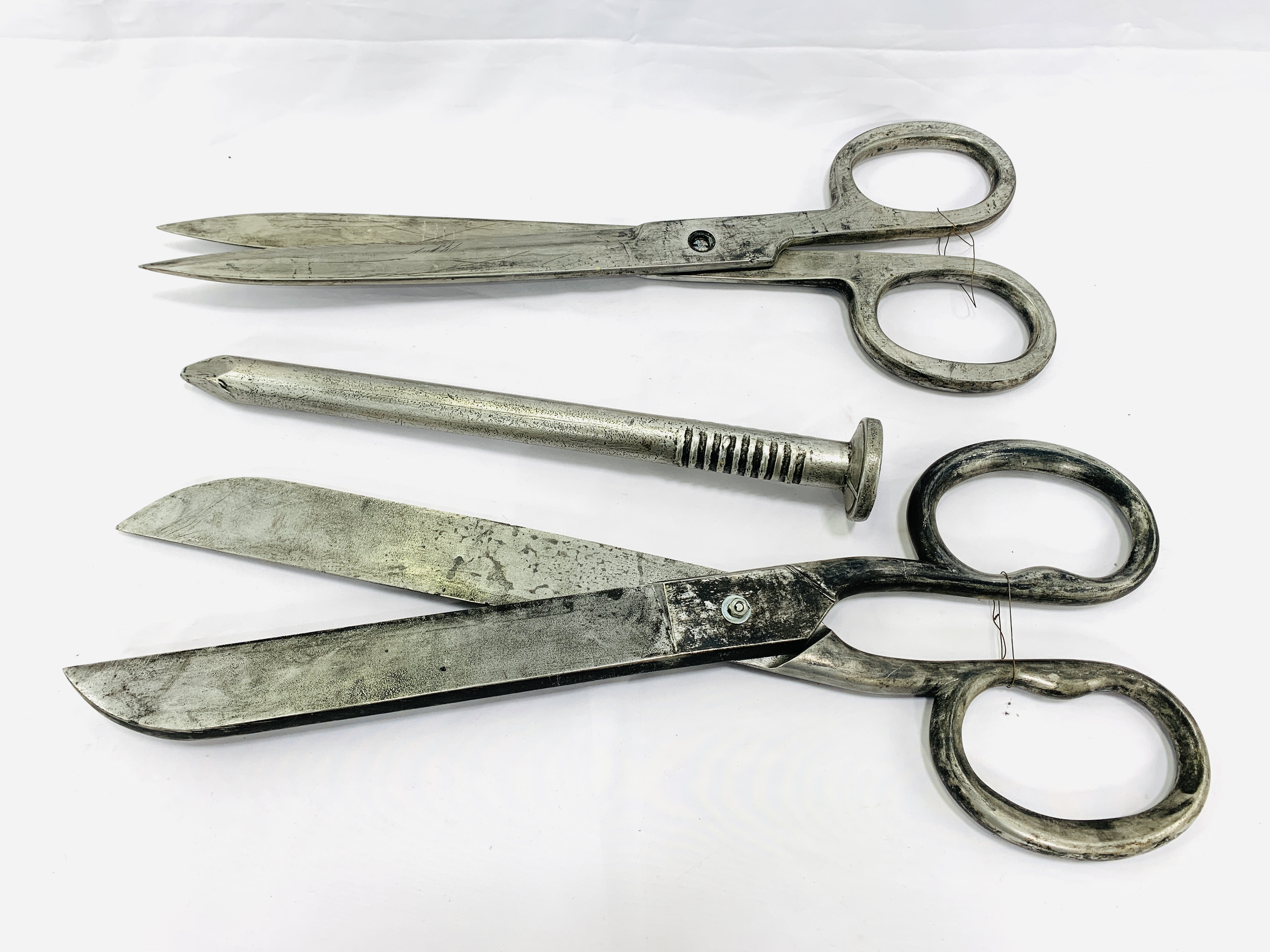 Two pairs of Victorian industrial style scissors, and a large resin nail