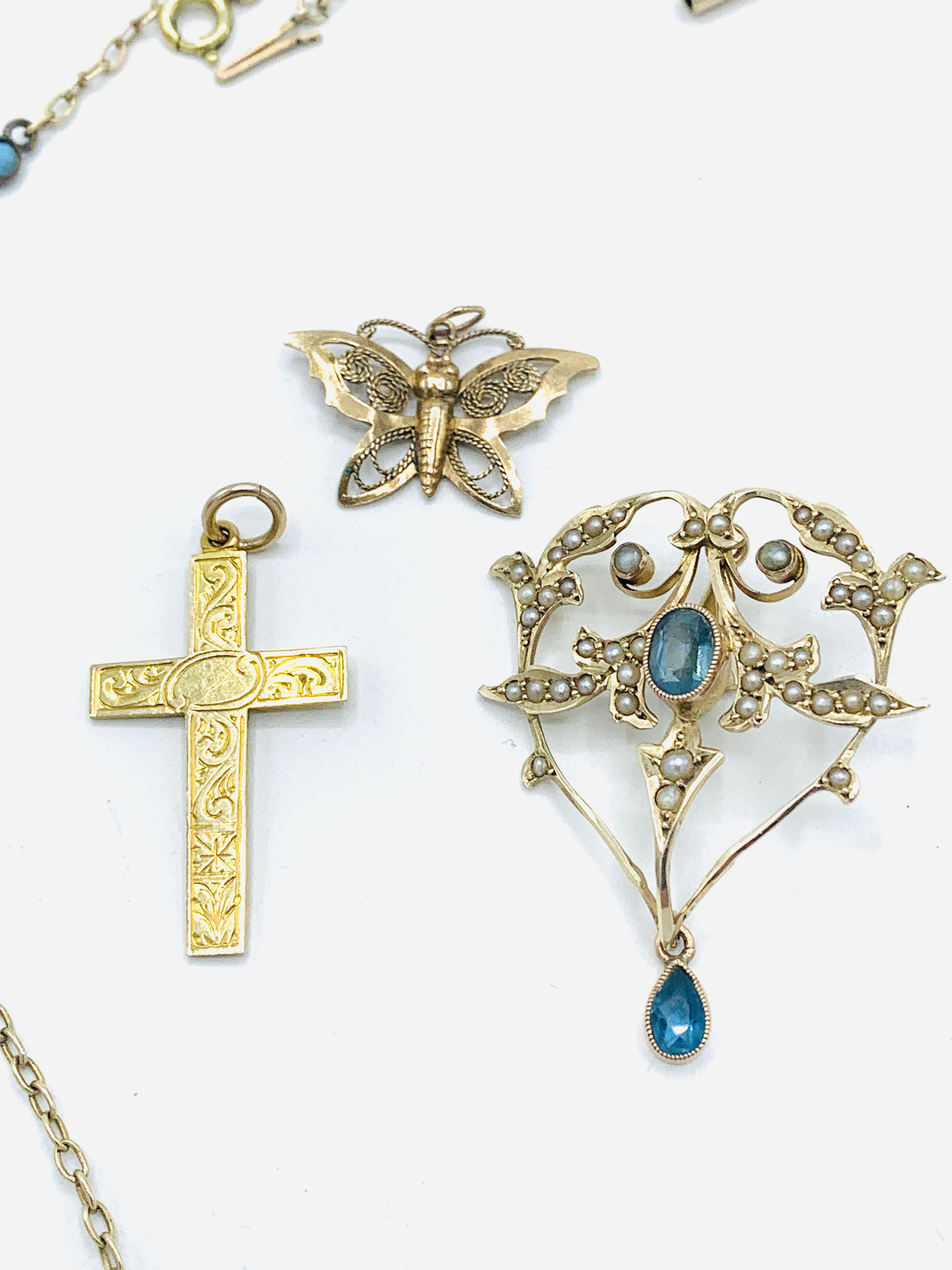 9ct gold aquamarine and seed pearl pendant; gold and turquoise chain; gold cross; butterfly brooch - Image 2 of 5