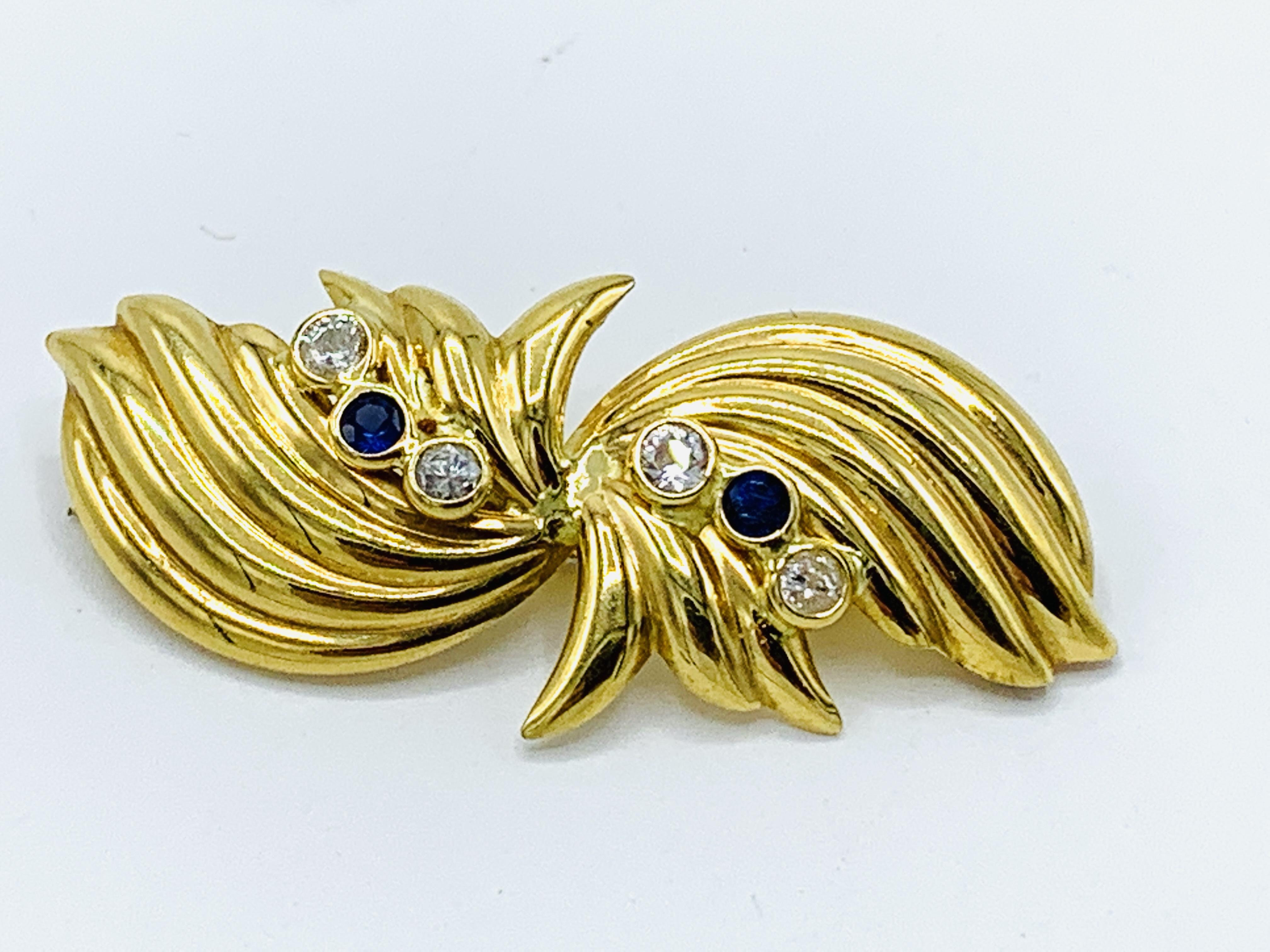Contemporary Italian bow design 18ct gold brooch
