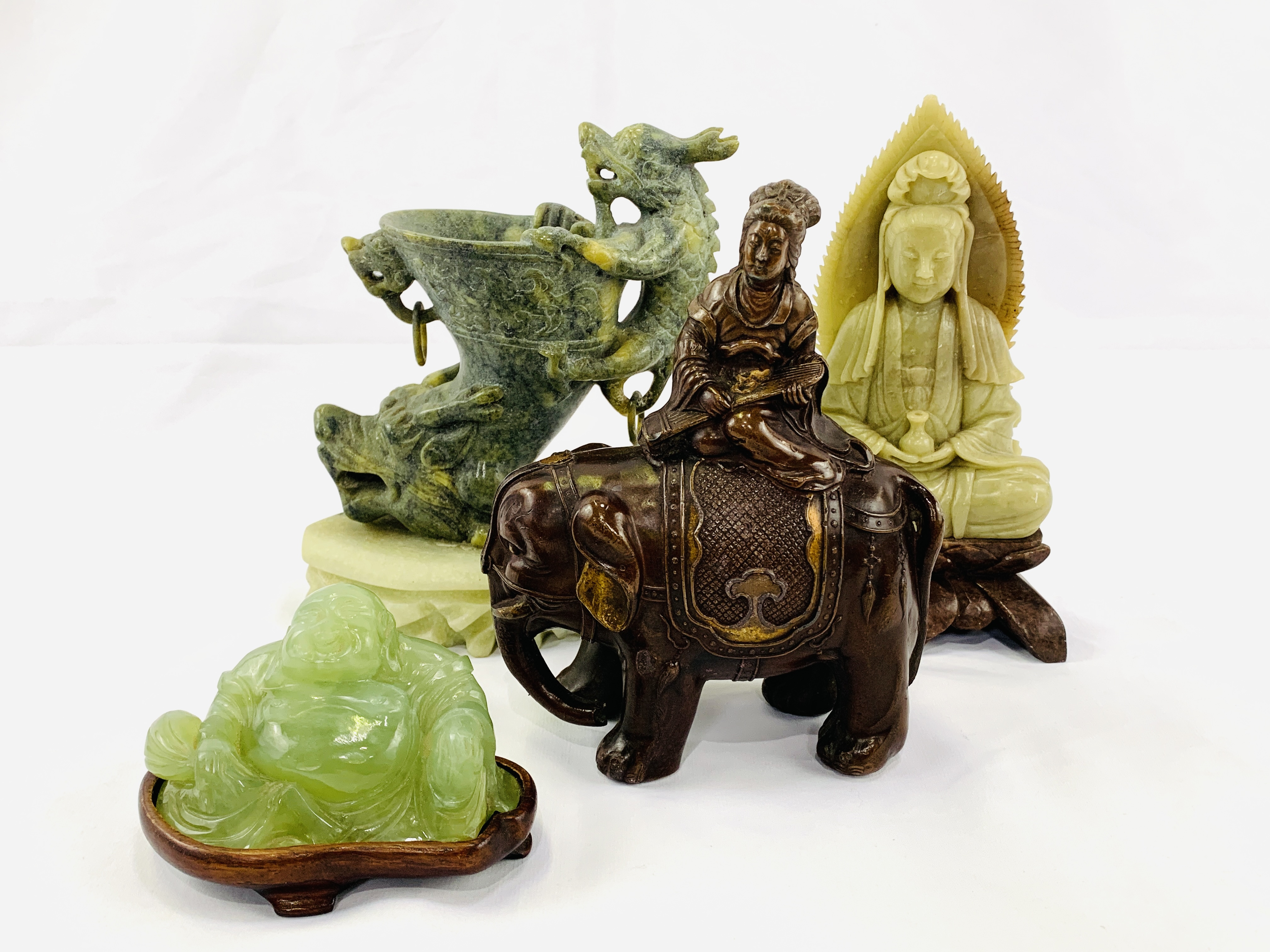 Four pieces of Oriental carved stone