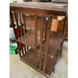 Mahogany revolving bookcase, chest of drawers, leather suitcase, oak stand and pine wall mirror
