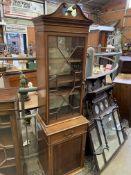 A mahogany glazed bookcase with adjustable shelves