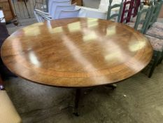Inlaid mahogany oval tilt top dining table