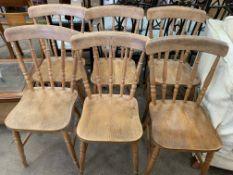 Six pine rail back chairs