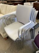 Four Cuscho light grey plastic and chrome stackable armchairs