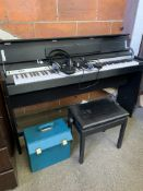 Roland DP-990 digital together with a stool and a case containing a charger