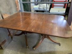Mahogany extendable pedestal dining table