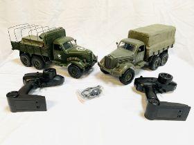 Two JJRC Q series 2.4G remote control off road military trucks