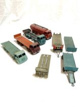 Four Dinky toys model lorries and flatbed trailers
