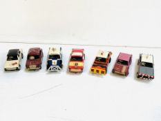 Seven Airfix slot cars.