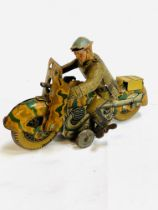 Tinplate clockwork military motorcyclist.