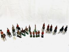 Collection of painted metal soldiers, mainly calvary