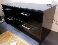1 x Glass Topped 4-Door TV Unit In A Black Gloss Finish - Dimensions: 121 x 50 x H61cm - NO VAT