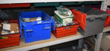 5 x Storage Crates Containing Various Metal Brackets and BritClips For Electrical Cable Installation
