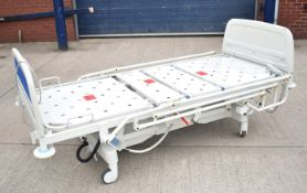 1 x Huntleigh CONTOURA Electric Hospital Bed - Features Rise/Fall 3-Way Profiling, Side Rails,