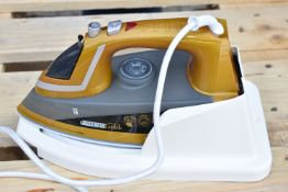 Assorted Collection of Laundry Equipment Including Phoenix Gold Steam Iron, Two Ironing Boards and