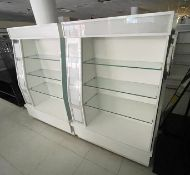 2 x Retail Display Islands Featuring White Finish, Glass Shelves, Illuminated Light Boxes, Mirrors