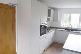 1 x Contemporary Handleless Fitted Kitchen Featuring A White Finish, Laminate Worktops, And