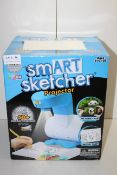 BOXED TOTY SM-ART SKETCHER PROJECTOR RRP £99.00Condition ReportAppraisal Available on Request- All