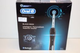 BOXED ORAL B POWERED BY BRAUN SMART SERIES BLACK 6500 TOOTHBRUSH RRP £129.00Condition