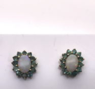 Opal and Emerald earrings set in Yellow Gold
