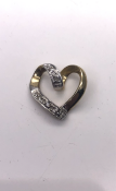 9ct yellow gold heart shaped diamond pendant set with 5 round diamonds 0.8g