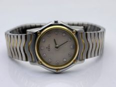 LADIES EBEL WATCH, 18CT YELLOW GOLD AND STAINLESS STEEL WITH MOTHER OF PEARL FACTORY DIAMOND DOT