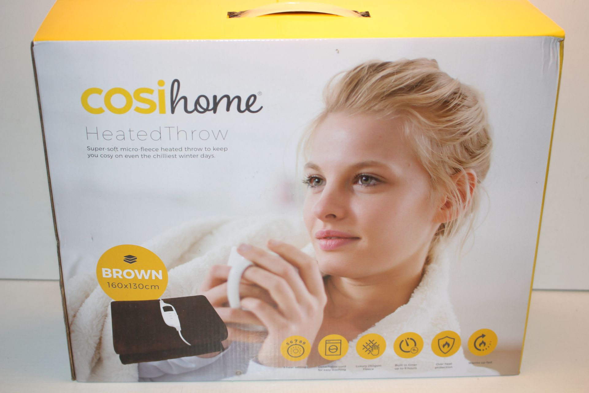 BOXED COSI HOME HEATED THROW BROWN 160 X 130 CM RRP £54.99Condition ReportAppraisal Available on