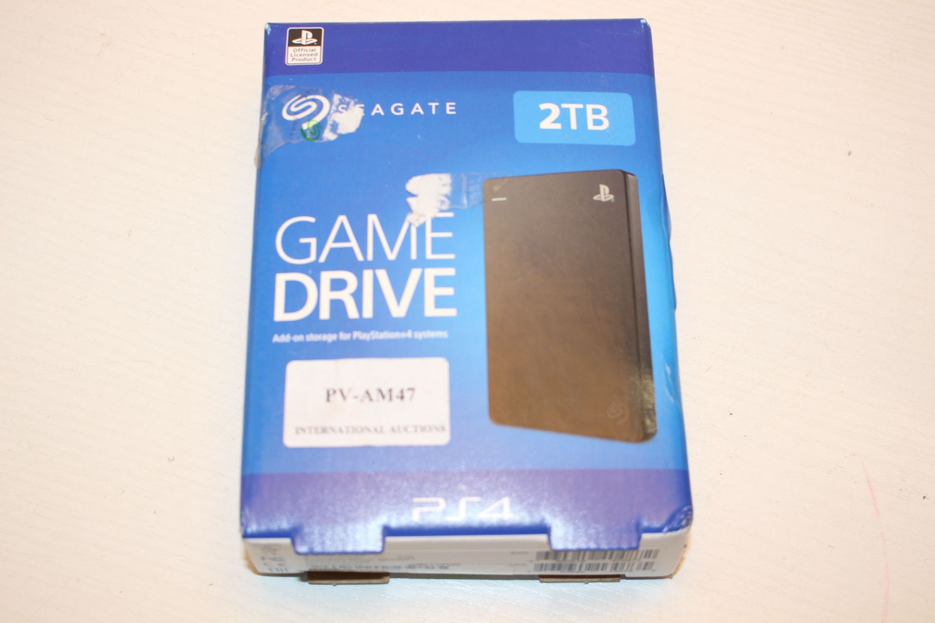 BOXED SEAGATE GAME DRIVE 2TB FOR PS4 RRP £83.77Condition ReportAppraisal Available on Request- All