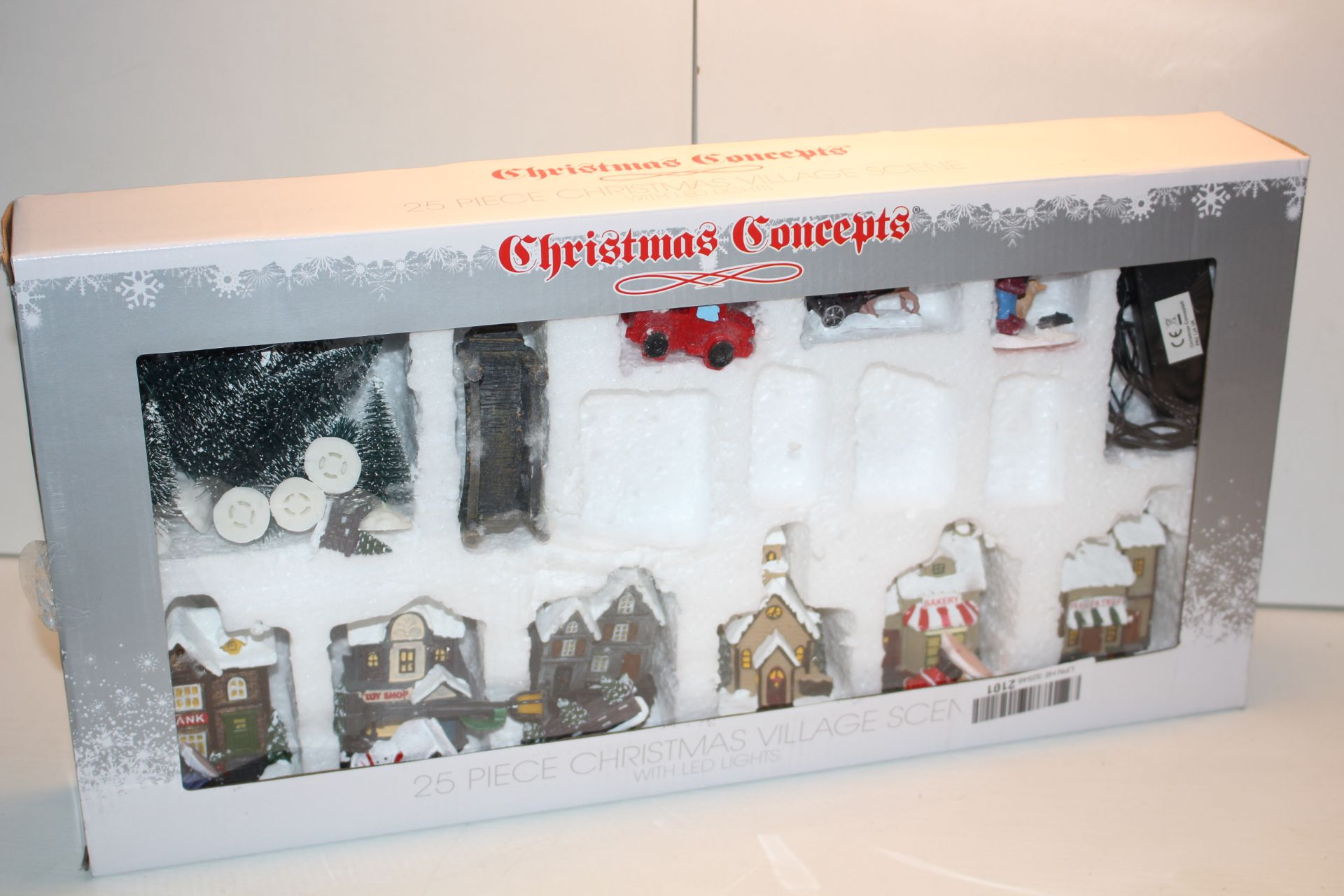 BOXED CHRISTMAS CONCEPTS 25 PIECE CHRISTMAS VILLAGE SET Condition ReportAppraisal Available on