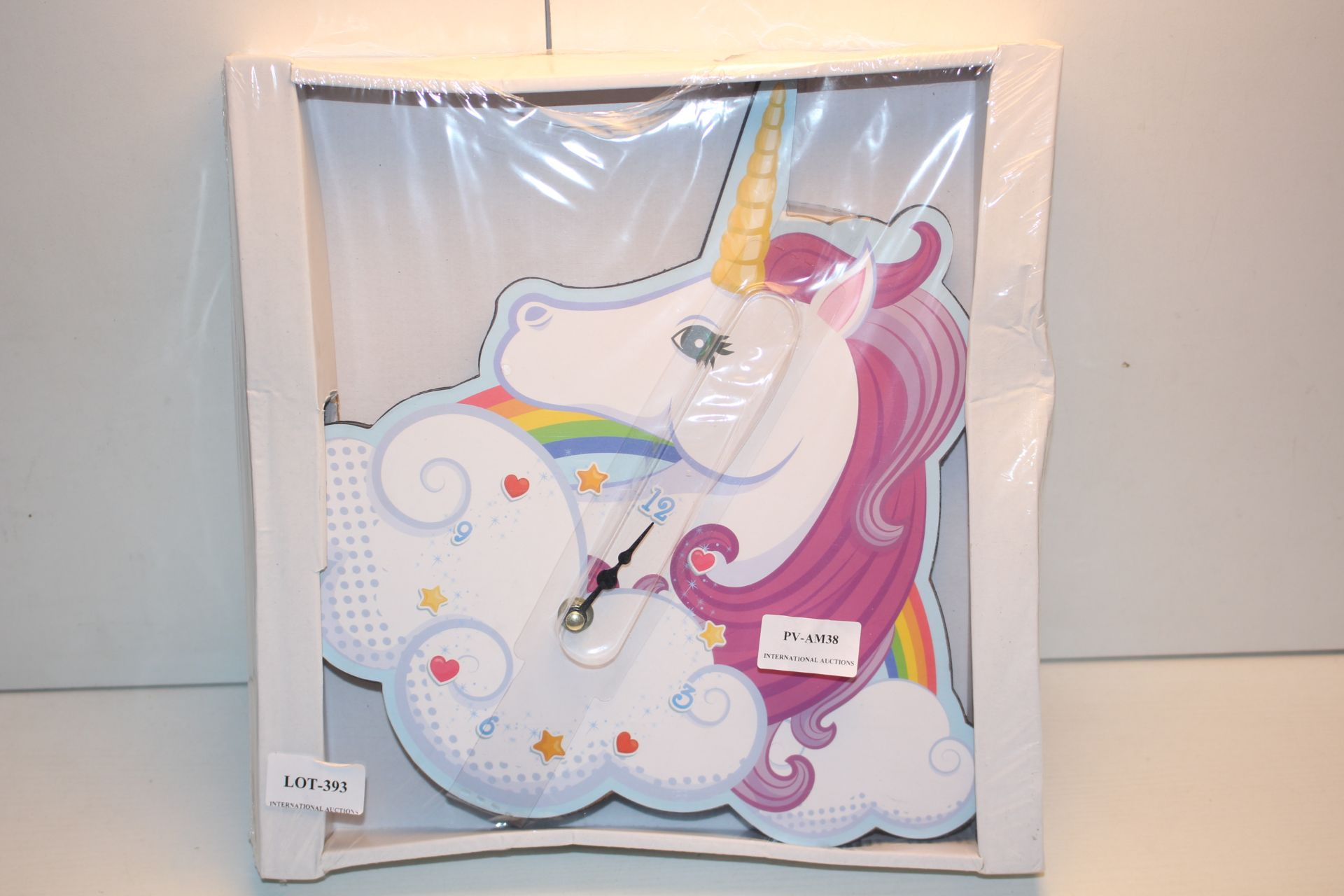 BOXED UNICORN WALL CLOCK RRP £18.99Condition ReportAppraisal Available on Request- All Items are