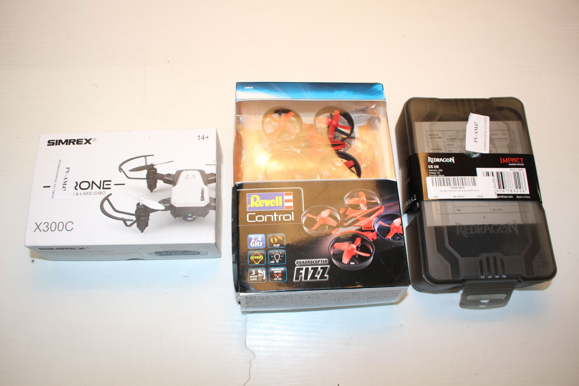 3X ASSORTED BOXED ITEMS TO INCLUDE SIMREX DRONE, REVELL CONTROL QUADCOPTER & REDRAGON Condition