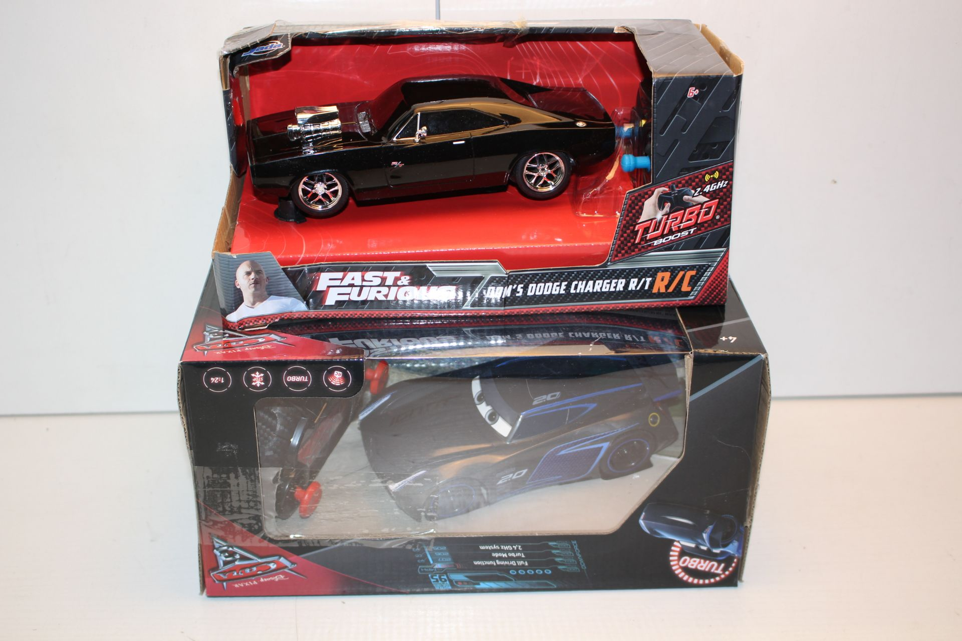 2X BOXED RC CARS TO INCLUDE FAST & FURIOUS DODGE CHARGER & DISNEY CARS TURBO Condition