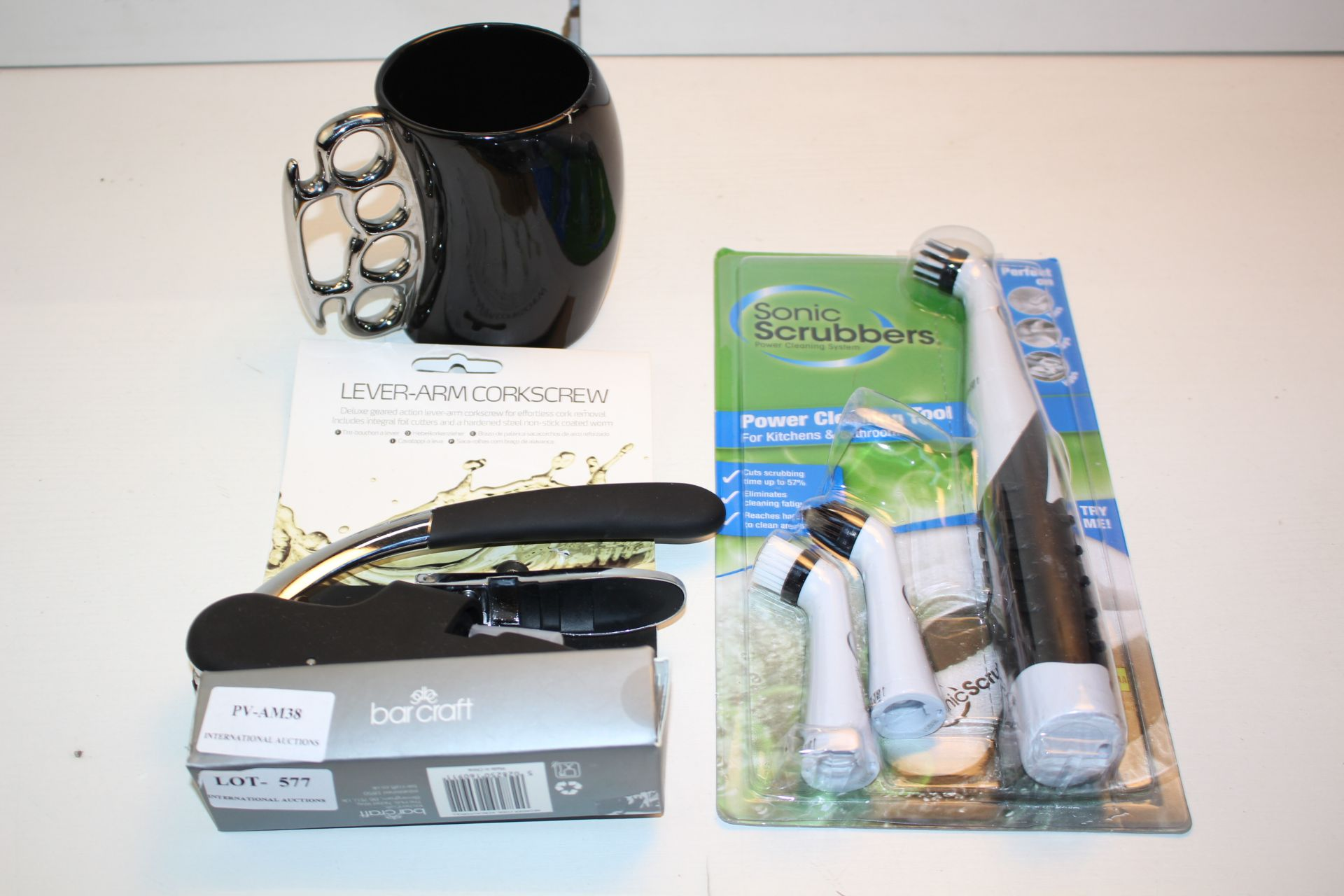 X3 KITHEN ITEMS INCLUDING CUP, LEVER ARM CORKSCREW AND SONIC SCRUBCondition ReportAppraisal