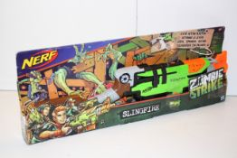 BOXED NERF ZOMBIE STRIKE SLINGFIRE GUN RRP £29.99Condition ReportAppraisal Available on Request- All