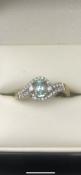 9 carat yellow gold aquamarine ring set with 0.4 carats of diamondsSize O