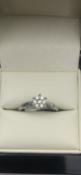 18 carat white gold diamond ring set with 7 diamonds total 0.15 carat diamondSize L