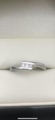 9 carat white gold diamond twist ring set with 3 square diamondsSize P