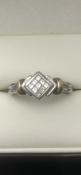 9 carat white gold diamond ring set with 9 diamonds total carat 0.2 Size N