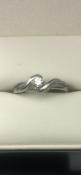 9 carat white gold solitaire diamond twistringSize L