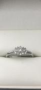 9 carat white gold diamond cluster ringTotal diamond carat 0.15size M