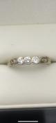 9 carat yellow gold 3 stone diamond ringSize N