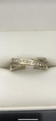 9 carat yellow gold diamond twist ringSet with 10 diamondsSize I