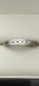 9 carat yellow gold diamond ringSet with 5 diamonds total 0.2 caratSize N